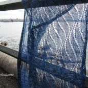 blue lace wrap with sea in background