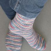 Stripey socks on feet and left heel