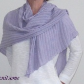 Lilac-coloured shawl wrapped on shoulders